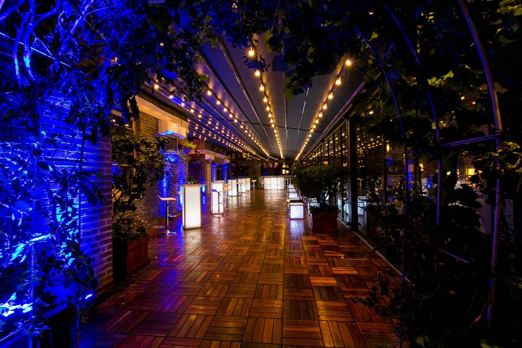 terrace decorated for evening event - Midtown Productions