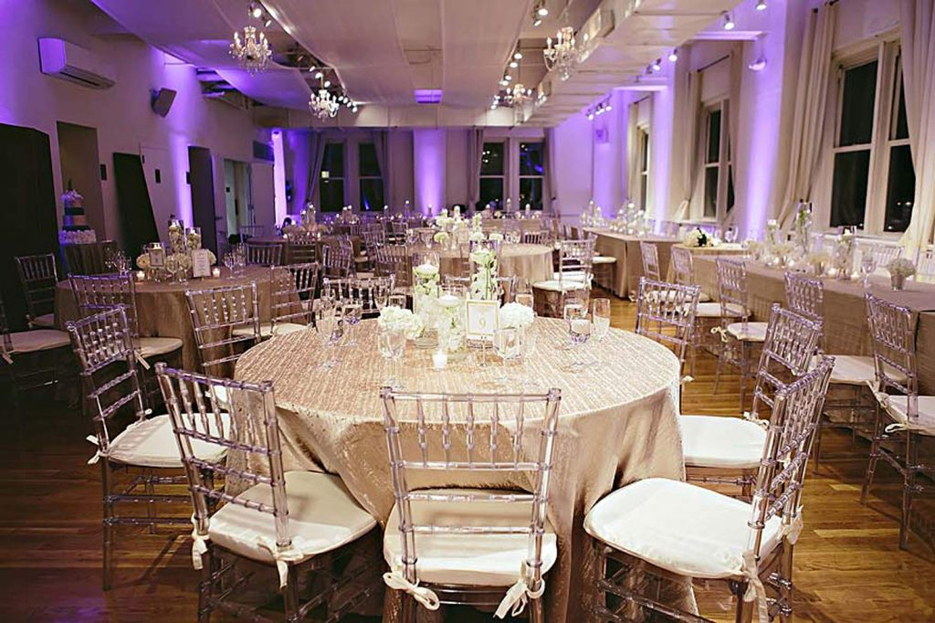 tables set up for wedding reception - Midtown Productions