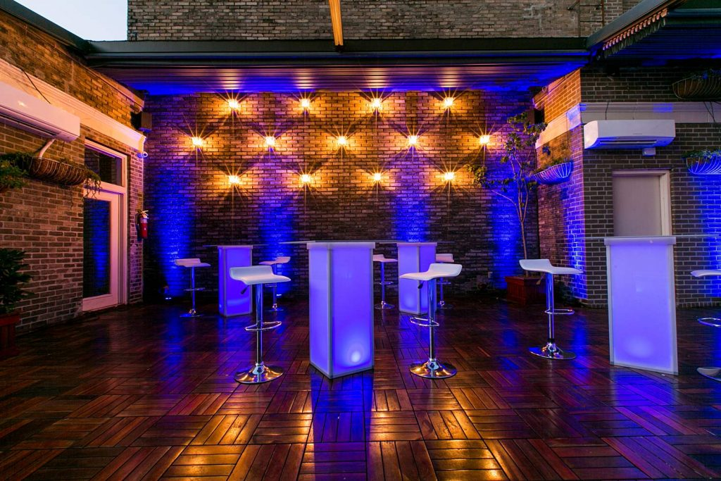 purple lit high top tables - Midtown Productions