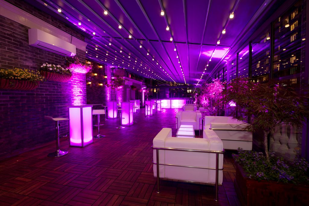 pink illuminated bar furniture on terrace - Midtown Productions