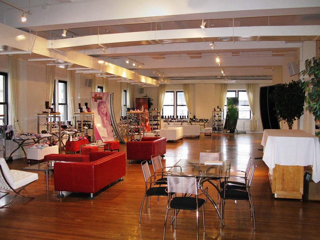 Red couches in loft - NYC corporate event space
