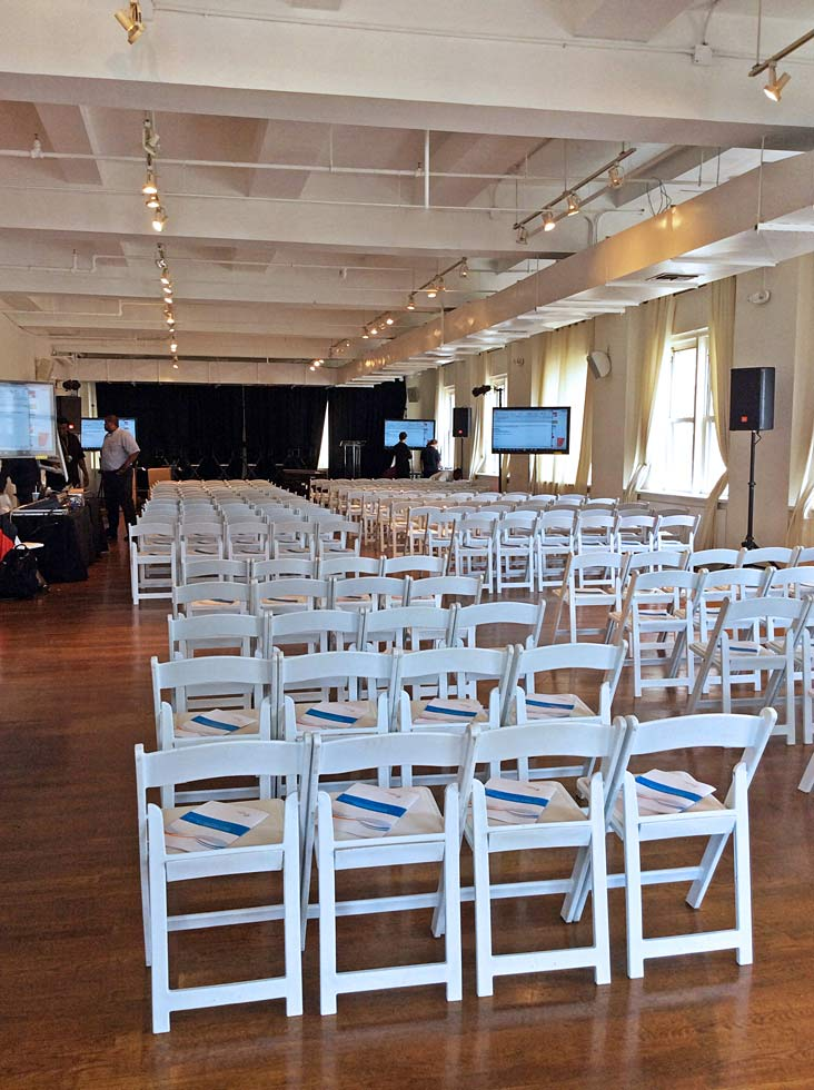 White chairs set up for talk - NYC corporate event space