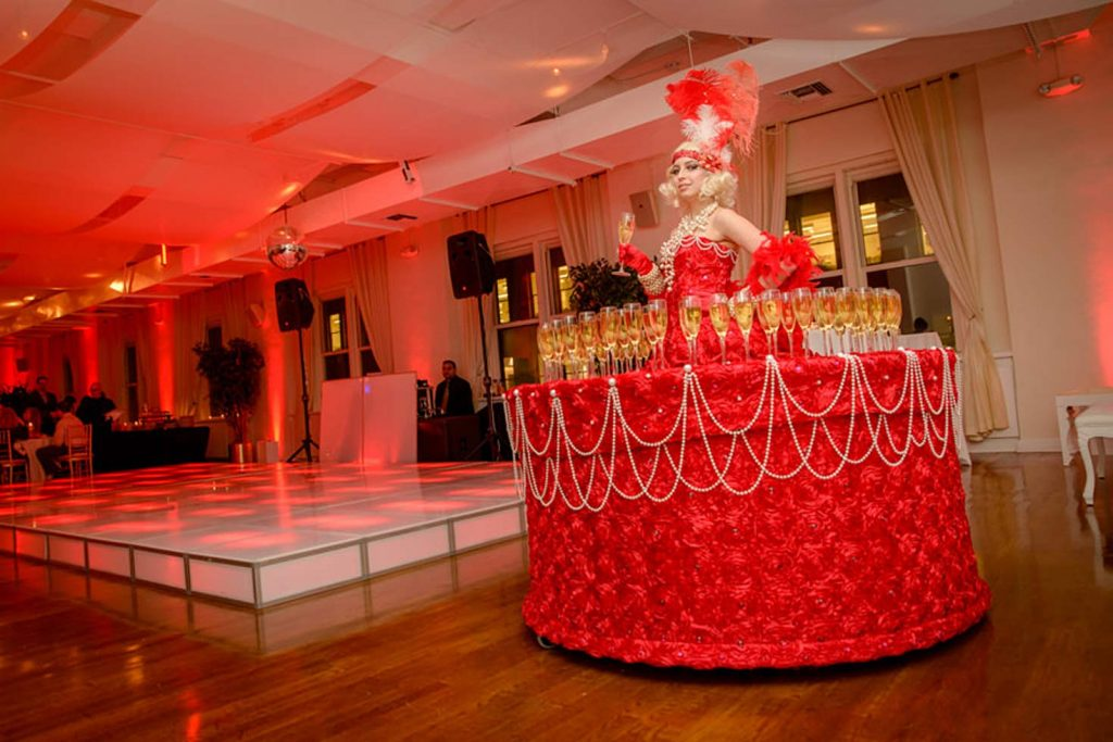 Champagne on red decorated table - NYC corporate event space