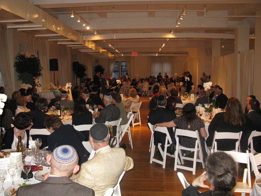 guests seated at tables - Midtown Loft