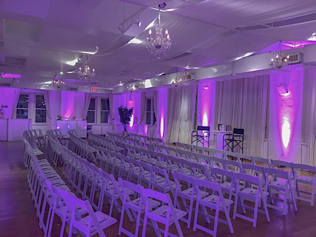 White chairs with purple lighting - NYC corporate event space