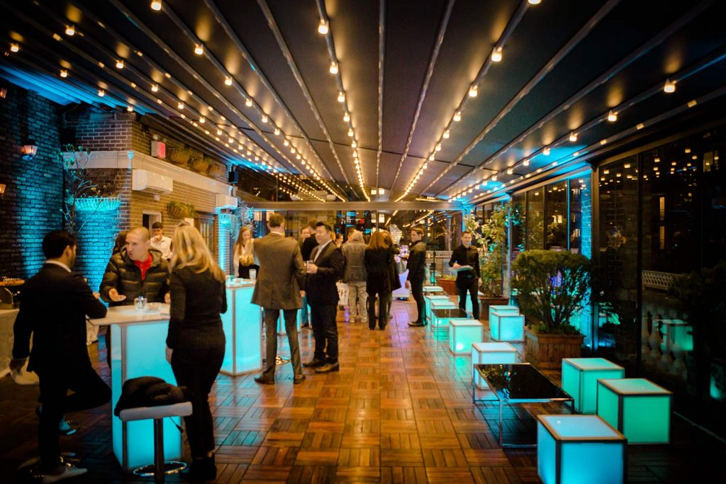 guests at blue high top tables - NYC corporate event space