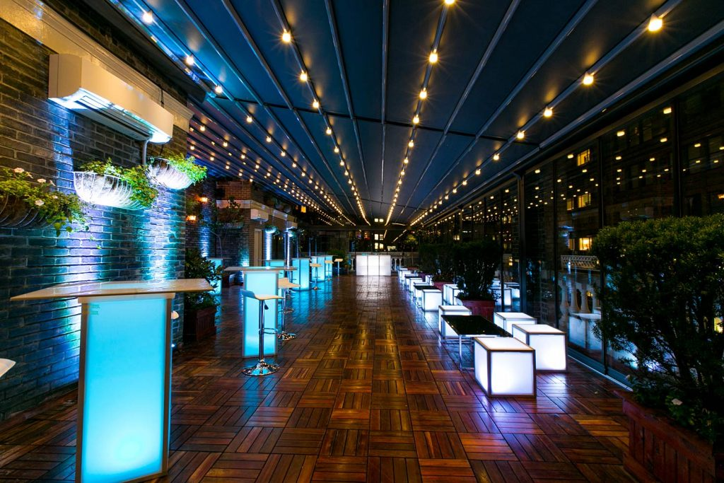 blue bar furniture on terrace - NYC corporate event space