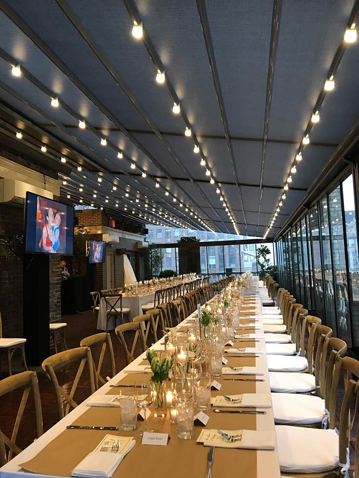 long tables on terrace - NYC corporate event space