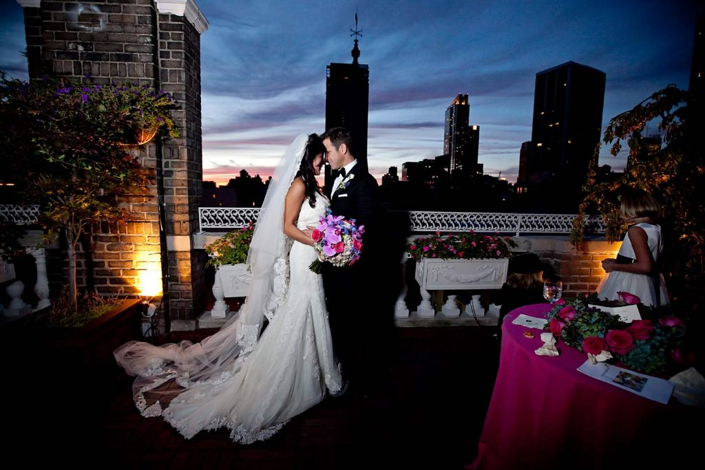 #6: Bride and groom in front of New York skyline