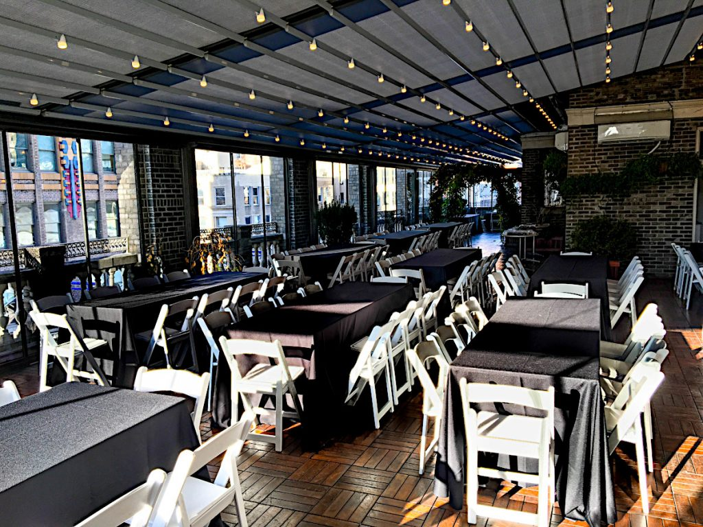 white chairs with black tablecloths - NYC corporate event space