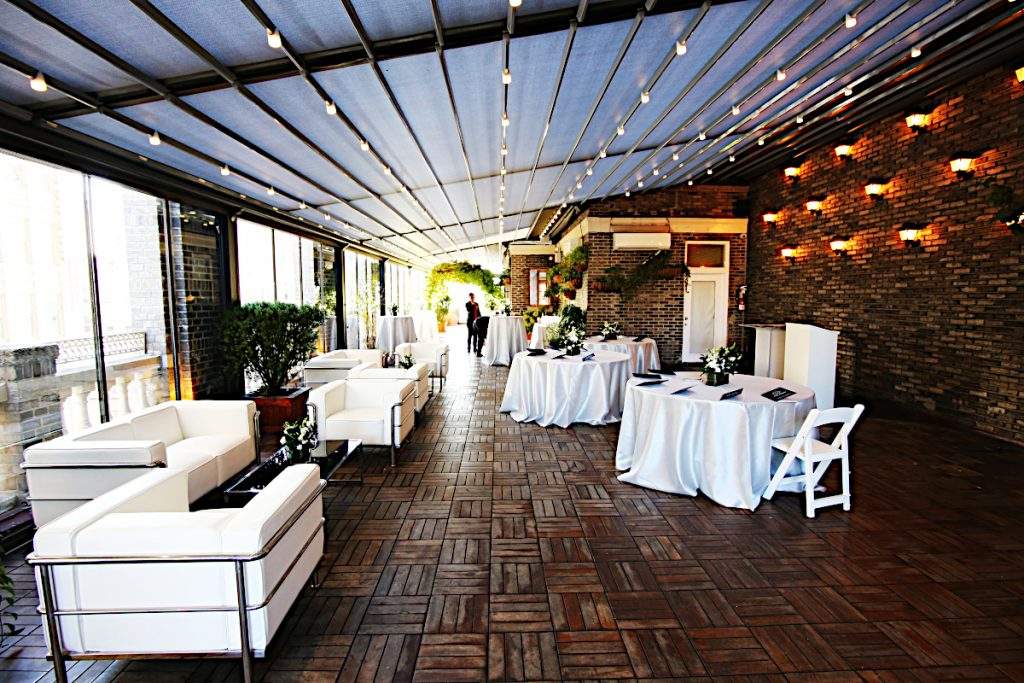white couches and linens - NYC corporate event space