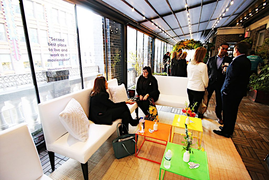 colored tables with white couches - NYC corporate event space