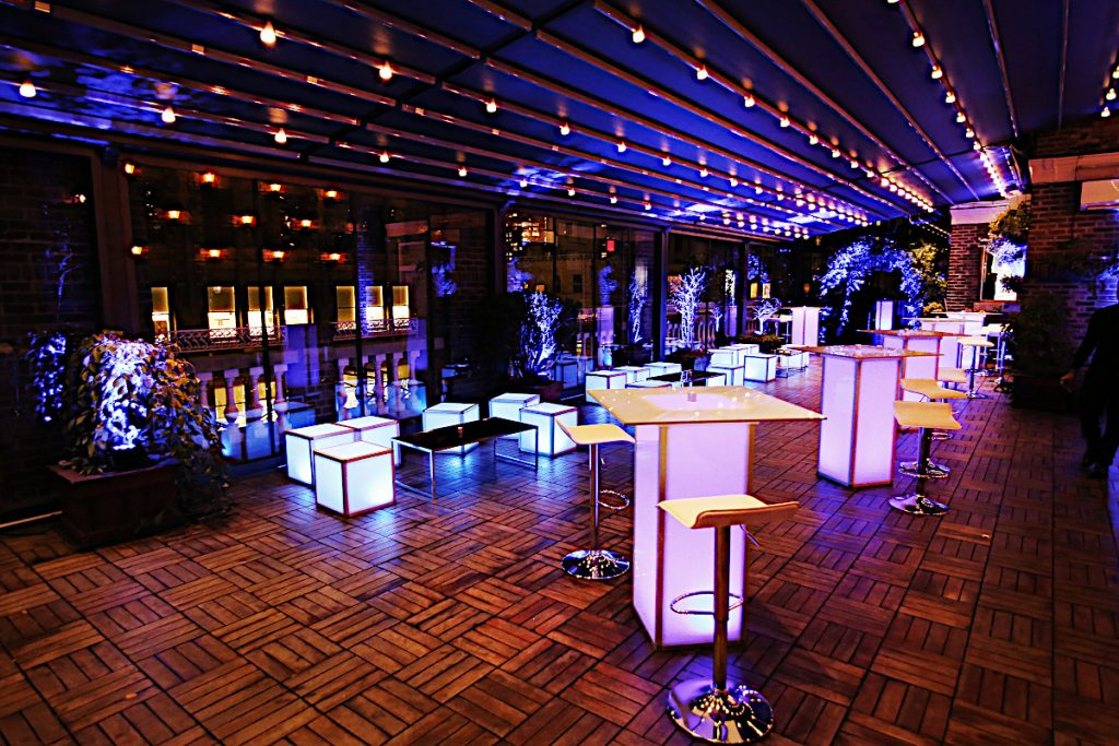 pink and white furniture on terrace - NYC corporate event space
