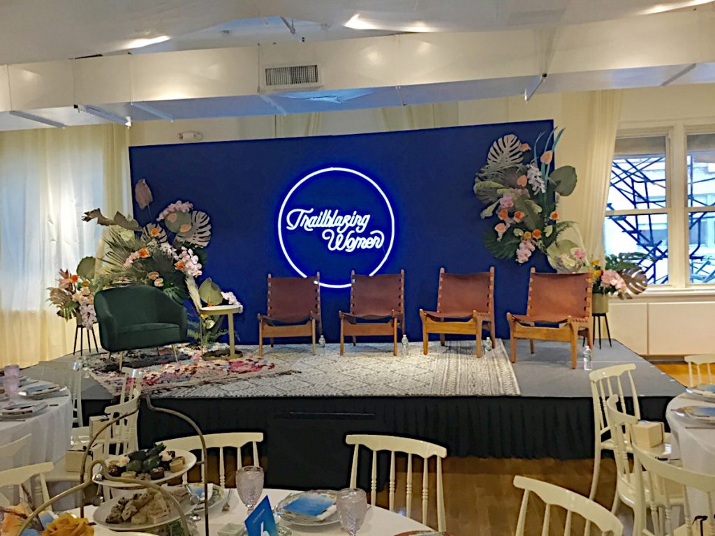 Stage set with flowers and chairs - NYC corporate event space