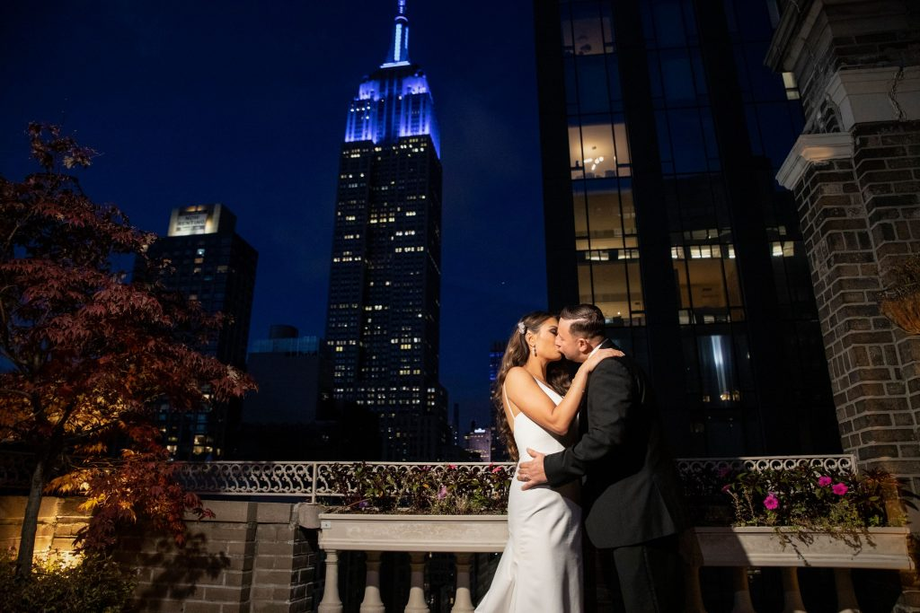 Bride and groom with snow - Midtown Terrace