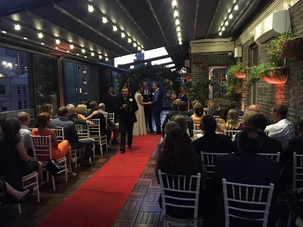 evening wedding ceremony - Midtown Terrace