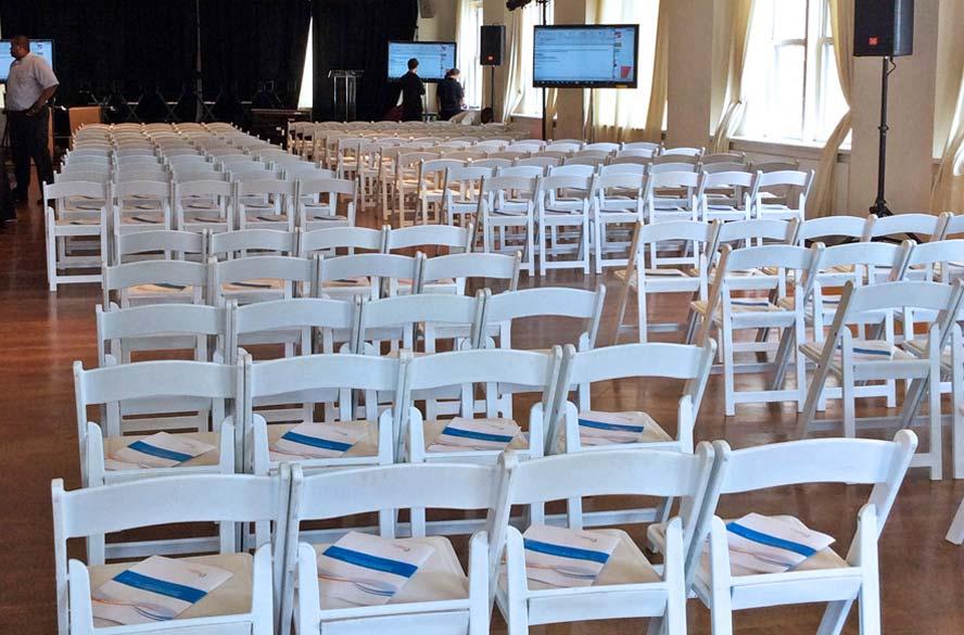 White Padded Chairs: $750